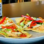 Coconut Ginger Chicken Nachos with a rice vinegar slaw