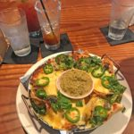 Nachos with added beef short ribs with a wicked Bloody Mary at Tavern in Nashville TN.